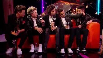 Backstage at the BRITs- One Direction Talks to Laura Whitmore - BRITs 2013