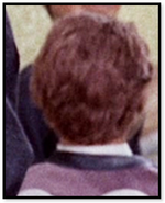 Man in purple jacket back to camera