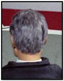 Grey haired man (black jacket)