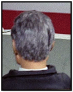 Grey haired man (black jacket)