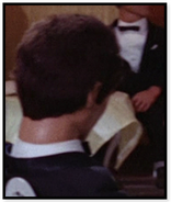 Man with brown hair (back to camera)