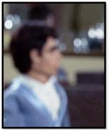 Man with light blue jacket