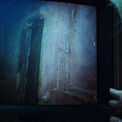 Old Rose touching the screen as the footage explores the ruins of the Titanic