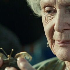 Old Rose holding her butterfly comb