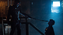 Deathstroke pointing his sword at Jason
