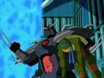 Utrom Shredder holds Leo