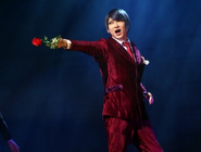 Tsukiyama brandishing a rose