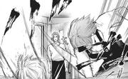 Touka smacks Kaneki onto the countertop
