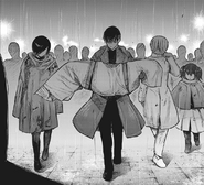 Urie carries Kaneki's body