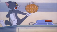 Tom's Tail Into A Waffle