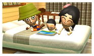 Baby reading with parents