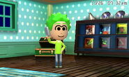 Mii on his cellphone
