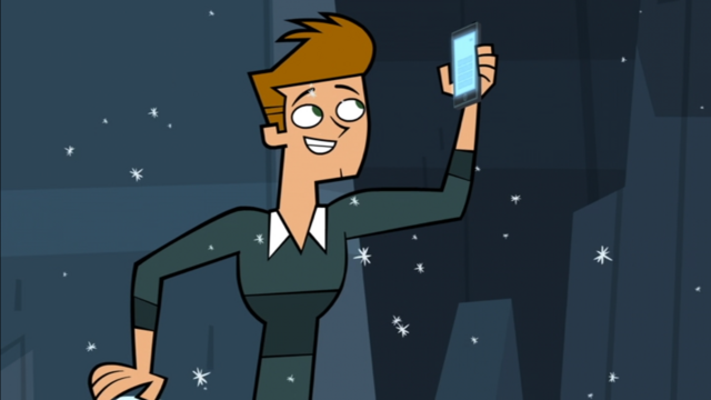 File:Topher with phone.png