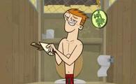 Scott w kostiumie kąpielowym w pokoju zwierzeń