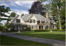 Exterior 2 of stone colonial house by McIntyre Capron Architects