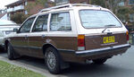 Brown and beige station wagon automobile