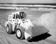 A 1970s Weatherill L66D 4WD Loader Diesel working in a beach