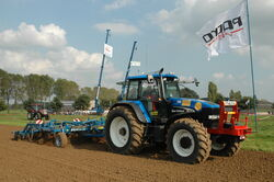 New Holland TM190 with Köckerling Quadro, side