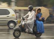 Monsoon couple on motorcycle