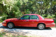 Red 1999 Ford Crown Victoria