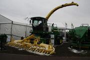 John Deere 7580 forager + maize harvester at Lamma 2013 IMG 6346