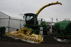 John Deere 7580 forager + maize harvester at Lamma 2013 IMG 6346