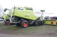Claas Lexion 750 combine (side) at LAMMA 2011 - IMG 6062