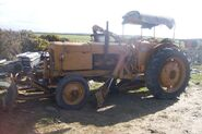 A 1950s Aveling-Barford Grader Fordson Tractor based