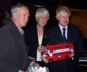 Boris Johnson -holding a red model bus -2007