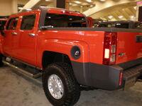 2009 red Hummer H3T Crew Cab Alpha side rear