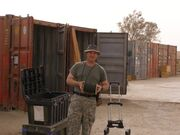 GI loads a shipping container