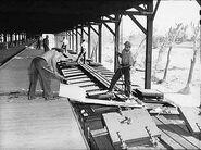 Men loading ice blocks into reefers