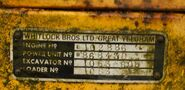 1960s Whitlock Brothers nameplate on a loader