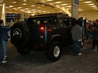 2005 blue Hummer H2 rear