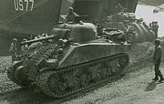 Shermans disembarking from LST at Anzio crop