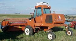 Co-op Implements 550 swather (red) - 1979