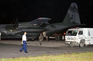 Hércules C-130 pousado