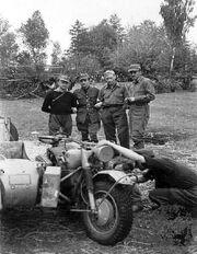 Warsaw Uprising by Gąszewski - Fixing motorcycle of Kampinos Regiment