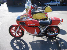 Vintage Yamaha sportbike and Vespa scooter.jpg
