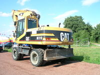 Caterpillar M318 with grab (rear)
