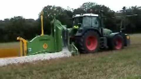 RWT 100S ROCK WHEEL TRENCHER IN ACTION