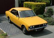 Mitsubish Galant Yellow on a driveway