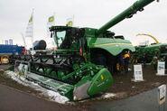 John Deere S690i tracked combine at LAMMA 2013 IMG 6376