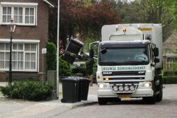 Refuse truck collecting refuse in Aardenburg April 2009