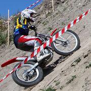 Motorcycle trials bike uphill