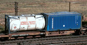 Railroad car with container loads