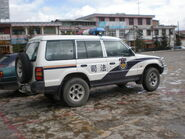 Police SUV in Old Town of Shangri-La parking lot