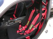 Bucket seat with Schroth six-point harness in a 2010 Porsche 997 GT3 RS 3.8