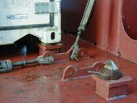 Twistlock and lashing rods