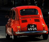 Red Fiat Cinquecento in Lisbon